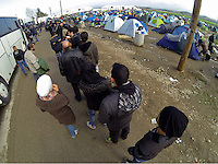 Pictured: A queue of migrants at the camp Tuesday 01 March 2016<br />
