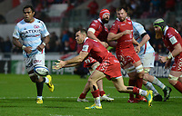 Scarlets' Gareth Davies whips the ball out wide<br /> <br /> Photographer Ian Cook/CameraSport<br /> <br /> European Rugby Champions Cup - Scarlets v Racing 92 - Saturday 13th October 2018 - Parc y Scarlets - Llanelli<br /> <br /> World Copyright © 2018 CameraSport. All rights reserved. 43 Linden Ave. Countesthorpe. Leicester. England. LE8 5PG - Tel: +44 (0) 116 277 4147 - admin@camerasport.com - www.camerasport.com