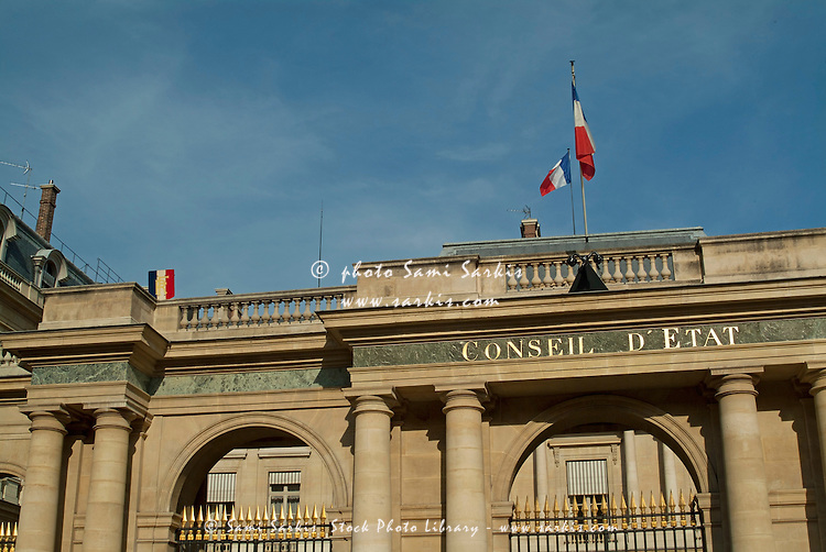 French flags flying outside the Conseil d'Etat, a government building in Paris, France.
