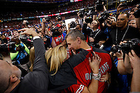 Ohio State Buckeyes head coach Urban Meyer celebrates with his wife Shelley following Ohio State's win over Alabama in the Allstate Sugar Bowl college football playoff semifinal at the Mercedes-Benz Superdome in New Orleans on Jan. 1, 2015. (Adam Cairns / The Columbus Dispatch)