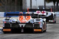 Prototype traffic exiting the Sebring hairpin in 2009.