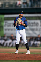 Missoula Osprey starting pitcher Edgar Martinez (15) prepares to deliver a pitch during a Pioneer League game against the Grand Junction Rockies at Ogren Park Allegiance Field on August 21, 2018 in Missoula, Montana. The Missoula Osprey defeated the Grand Junction Rockies by a score of 2-1. (Zachary Lucy/Four Seam Images)
