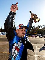 Feb 12, 2017; Pomona, CA, USA; NHRA top fuel nitro Harley rider Jay Turner celebrates after winning the Winternationals at Auto Club Raceway at Pomona. Mandatory Credit: Mark J. Rebilas-USA TODAY Sports