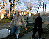 United States Senator Hillary Rodham Clinton (Democrat of New York), right,  is smiling after her primary victories in Ohio, Rhode Island, and Texas last evening after she and her husband, former United States President Bill Clinton, left, return from a late afternoon walk near their home in Washington, D.C. on Wednesday, March 5, 2008.  <br /> Credit: Ron Sachs / CNP<br /> (RESTRICTION: NO New York or New Jersey Newspapers or newspapers within a 75 mile radius of New York City)