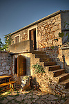 A room for rental at Konoba Humac...Konoba Humac, owned by the Franicevic family,  is a restaurant which combines traditional Croatian tavern food with an exotic setting in the abandoned agricultural village of Humac on a mountain peak on the Island of Hvar, Croatia. All the food is organic and picked by its diners from the fields nearby. Konoba Humac is an entrepreneurial combination of traditional dining and ecotourism trends. Photo copyright 2007 www.lawrencelucier.com