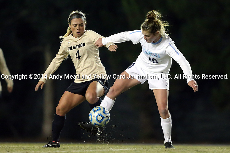 21 November 2014: North Carolina's Joanna Boyles (10) and Colorado's Madison Krauser (4). The University of North Carolina Tar Heels hosted the University of Colorado Buffaloes at Fetzer Field in Chapel Hill, NC in a 2014 NCAA Division I Women's Soccer Tournament Second Round match. UNC won the game 1-0 in overtime.