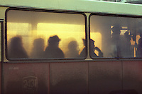 ROMANIA, BUcharest, 1986..Shadows in the windows of a bus..ROUMANIE, Bucarest, 1986..Ombres derrière les vitres d'un bus..© Andrei Pandele / EST&OST