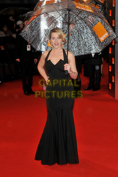 KATE WINSLET .The Orange British Academy Film Awards 2009, Royal Opera House, Covent Garden, London, England, February 8th 2009..BAFTAS arrivals full length black dress umbrella raining weather long maxi halterneck hand on hip .CAP/PL.©Phil Loftus/Capital Pictures