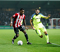 Josh Clarke of Brentford takes on Jamie Hanson of Derby County during the Sky Bet Championship match between Brentford and Derby County at Griffin Park, London, England on 26 September 2017. Photo by Carlton Myrie / PRiME Media Images.