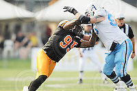 September 7, 2009; Hamilton, ON, CAN; Hamilton Tiger-Cats defensive lineman Justin Hickman (95). CFL football - the Labour Day Classic - Toronto Argonauts vs. Hamilton Tiger-Cats at Ivor Wynne Stadium. The Tiger-Cats defeated the Argos 34-15. Mandatory Credit: Ron Scheffler.