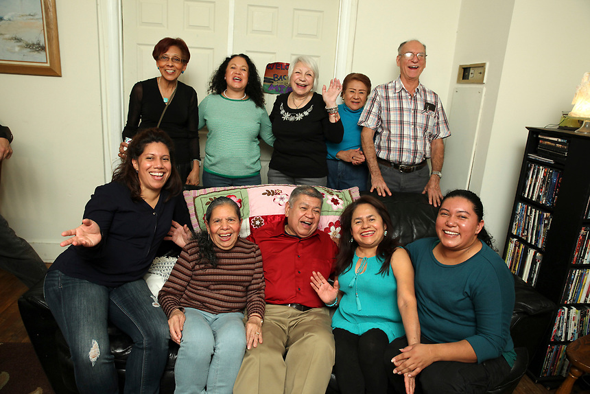 (171202RREI2326) Long-time family active in saving the Kenesaw Condominiums.  La Esquina Documentary Project. Latinos have gathered near the 7 - 11 at the corner of Mt. Pleasant St. and Kenyon St. NW. for more than 40 years.  Mt. Pleasant, Washngton DC Dec. 2 ,2017 . ©  Rick Reinhard  2017     email   rick@rickreinhard.com