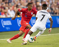 KANSAS CITY, KS - JUNE 26: Reggie Cannon #14 attacks against Jose Rodriguez #7 during a game between United States and Panama at Children's Mercy Park on June 26, 2019 in Kansas City, Kansas.