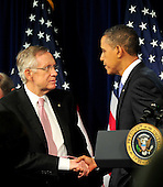 Washington, D.C. - January 4, 2010 -- United States President Barack Obama, right, shakes hands with U.S. Senate Majority Leader Harry Reid (Democrat of Nevada) after delivering remarks and taking questions from the Senate Democratic Policy Committee Issues Conference at the Newseum in Washington, D.C. on Wednesday, February 3, 2010..Credit: Ron Sachs / Pool via CNP