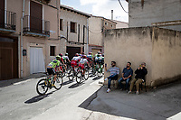 peloton rolling through town<br /> <br /> Stage 17: Aranda de Duero to Guadalajara (220km)<br /> La Vuelta 2019<br /> <br /> ©kramon