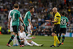 Real Madrid's Portuguese forward Cristiano Ronaldo argues with referee during the UEFA Champions League football match Real Madrid CF vs Schalke 04 FC at the Santiago Bernabeu stadium in Madrid on March 18, 2014.  PHOTOCALL3000/ DP