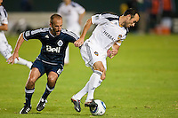 CARSON, CA - September 17, 2011: Vancouver Whitecaps midfielder Peter Vagenas (8) and LA Galaxy midfielder Landon Donovan (10) during the match between LA Galaxy and Vancouver Whitecaps at the Home Depot Center in Carson, California. Final score LA Galaxy 3, Vancouver Whitecaps 0.