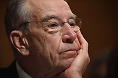 Senate Judiciary Committee chairman Senator Charles E. Grassley listens to Christine Blasey Ford, the woman accusing Supreme Court nominee Brett Kavanaugh of sexually assaulting her at a party 36 years ago, testify before the US Senate Judiciary Committee on Capitol Hill in Washington, DC, September 27, 2018.  / POOL / SAUL LOEB