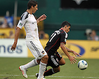 Pablo Hernandez #21 of D.C. United falls after a tackle from Omar Gonzalez #4 of the Los Angeles Galaxy during an MLS match at RFK Stadium on July 18 2010, in Washington D.C. Galaxy won 2-1.