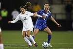 02 December 2011: Duke's Libby Jandl (3) defends against Wake Forest's Katie Stengel (12). The Duke University Blue Devils defeated the Wake Forest University Demon Deacons 4-1 at KSU Soccer Stadium in Kennesaw, Georgia in an NCAA Division I Women's Soccer College Cup semifinal game.