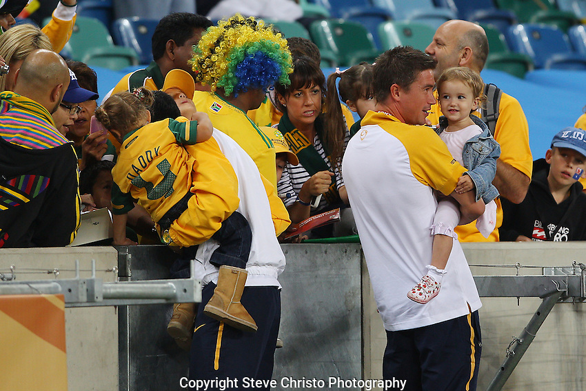Australia's Harry Kewel and Tim Cahill with their children before the match against Germany at Moses Mabhida Stadium, Durban, South Africa. Saturday 13th June 2010. (Photo: Steve Christo)