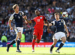 Scotland's Christophe Berra and Kieran Tierney tussle with England's Raheem Sterling during the FIFA World Cup Qualifying match at Hampden Park Stadium, Glasgow Picture date 10th June 2017. Picture credit should read: David Klein/Sportimage