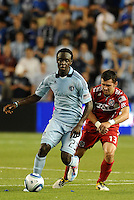 Kei Kamara (23) Sporting KC, Gonazalo Segares Chicago Fire...Sporting KC were held to a scoreless tie with Chicago Fire in the inauguarl game at LIVESTRONG Sporting Park, Kansas City, Kansas.