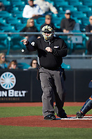 Home plate umpire Craig Mirr makes a strike call during the NCAA baseball game between the Illinois Fighting Illini and the Coastal Carolina Chanticleers at Springs Brooks Stadium on February 22, 2020 in Conway, South Carolina. The Fighting Illini defeated the Chanticleers 5-2. (Brian Westerholt/Four Seam Images)