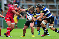 Nick Auterac of Bath Rugby takes on the Scarlets defence. Pre-season friendly match, between the Scarlets and Bath Rugby on August 20, 2016 at Eirias Park in Colwyn Bay, Wales. Photo by: Patrick Khachfe / Onside Images
