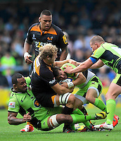 High Wycombe, England. Lee Dickson of Northampton Saints tackled by Joe Launchbury of Wasps during the Aviva Premiership match between Wasps and Northampton Saints at Adams Park on September 14, 2014 in High Wycombe, England.
