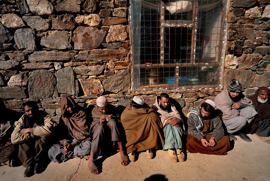 Afghanistan, Panjshir Valley.  November 2000.<br /> Panjshir Valley. A visit to prisoners, who have collaborated with the Talibans. Some of them are from Pakistan, like Khaled first left.<br /> <br /> <br /> Afghanistan. Vall&eacute;e du Panjshir. Novembre 2000. <br /> Visite de prisonniers ayant collabor&eacute; avec les talibans. Certains sont pakistanais, &agrave; l'instar de Khaled, le premier &agrave; gauche.