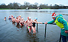 Serpentine Swimming Club <br /> Christmas Day Swimming race <br /> Serpentine, Hyde Park, London, Great Britain <br /> 25th December 2016 <br /> <br /> Robin helps people out of the water at end of race <br /> <br /> <br /> Photograph by Elliott Franks <br /> Image licensed to Elliott Franks Photography Services