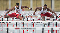 NWA Democrat-Gazette/BEN GOFF @NWABENGOFF<br /> Carl Elliott, III (left) and Shakiel Chattoo of Arkansas race in the final heat of the men's 110 meter hurdles Friday, April 12, 2019, at the John McDonnell Invitational at John McDonnell field in Fayetteville. Elliott won the event in 13.92 seconds with Chattoo in second.