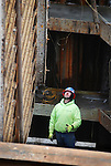 A worker watches a concrete form as it is lifted inside a cofferdam at the Duboistown Bridge. Arch Street, Newberry. PA.