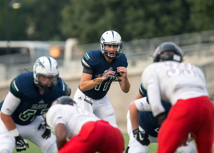 Quarterback Parker McNeil (11) prepares to take the snap during a high school football game between McNeil High School and Harker Heights High School at Kelly Reeves Stadium in Round Rock on Thursday, September 1, 2016.