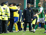 Hibs v St Johnstone...21.01.12.Steve Lomas gives Fran Sandaza a hug at full time.Picture by Graeme Hart..Copyright Perthshire Picture Agency.Tel: 01738 623350  Mobile: 07990 594431