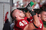 Andy Mattingly, Washington State University linebacker, takes in liquids while the defense rests on the bench awaiting their next turn on the field during a game against the Oregon Ducks on September 27, 2008, at Martin Stadium in Pullman, Washington.  The Ducks won the game 63-14.