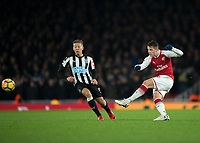 GranitXhaka of Arsenal shoots at goal past Dwight Gayle of Newcastle United during the Premier League match between Arsenal and Newcastle United at the Emirates Stadium, London, England on 16 December 2017. Photo by Vince  Mignott / PRiME Media Images.