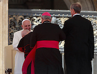 Papa Francesco saluta alcuni vescovi al termine dell'udienza generale del mercoledi' in Piazza San Pietro, Citta' del Vaticano, 16 aprile 2014.<br /> Pope Francis greets some bishops at the end of his weekly general audience in St. Peter's Square at the Vatican, 16 April 2014.<br /> UPDATE IMAGES PRESS/Isabella Bonotto<br /> <br /> STRICTLY ONLY FOR EDITORIAL USE