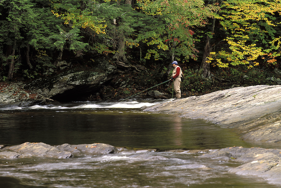 Fly fisherman fishing the North Branch of the Lamoille River, Waterville, Lamoille County, Vermont