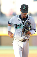 Dayton Dragons shortstop Jose Garcia (15) running in to the dugout between innings during a game against the Lansing Lugnuts at Cooley Law School Stadium on August 10, 2018 in Lansing, Michigan . Lansing defeated Dayton 11-4.  (Robert Gurganus/Four Seam Images)