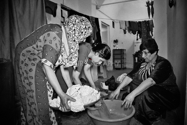 25..3.2015  Kirkuk,Iraq. Widad and her daughter (Nwr) preparing food with her christian neighbour.