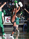 A North Texas Mean Green cheerleader does a high kick during the NCAA  basketball game between the Florida International University Panthers and the University of North Texas Mean Green at the North Texas Coliseum,the Super Pit, in Denton, Texas. UNT defeated FIU 87 to 77