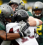 09/17/11-- Oregon's Eddie Pleasant and Isaac Remington sack Missouri State quarterback Trevor Wooden at Autzen Stadium in Eugene, Or....Photo by Jaime Valdez. ..............................................