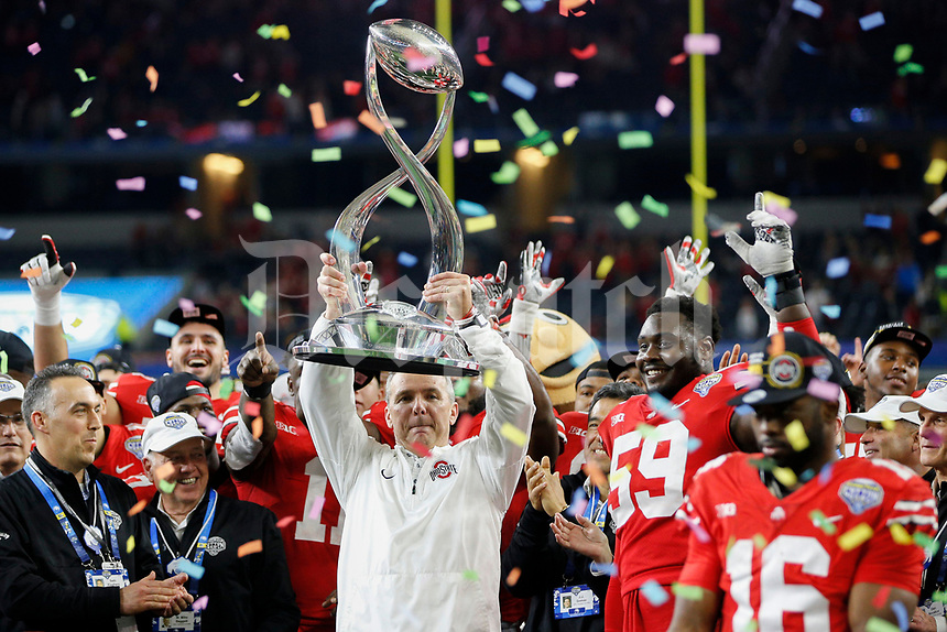 Ohio State Buckeyes head coach Urban Meyer hoists the Field Scovell Trophy following the Ohio State Buckeyes 24-7 victory against the USC Trojans during the Goodyear Cotton Bowl Classic on Friday, December 29, 2017 at AT&T Stadium in Arlington, Texas. [Joshua A. Bickel/Dispatch]