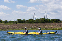 A group of kayakers paddle down the river in Charleston, SC.