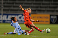 # 10 Carli Lloyd of the Chicago Red Stars tries to steal the ball away from #6 Lori Lohman of the Washington Freedom. The Red Stars won the game 2-1
