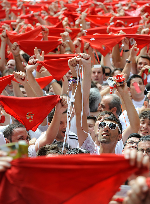 San Fermin, July 2012. Pamplona : Participants celebrate the 'chupinazo' in Pamplona. On each day of the San Fermin festival six bulls are released at 8:00 a.m. (0600 GMT) to run from their corral through the narrow, cobbled streets of the old navarre town over an 850-meter (yard) course. Ahead of them are the runners, who try to stay close to the bulls without falling over or being gored. Photo: Ander Gillenea.