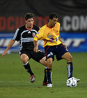 Monarcas Morelia midfielder Wanderson de Souza (10) shields the ball against DC United defender Devon McTavish (18). Monarcas Morelia tied DC United 1-1 in  the SuperLiga opening match of the group B, at RFK Stadium Washington DC, Wednesday July 26, 2007.