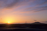 Sunset over sand dunes and ancient volcanoes, San Quintin, Baja California, Mexico