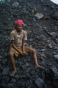 Ram Bhujian, a daily wage labourer poses for a portrait in Goladi coal depot in Jharia, outside of Dhanbad in Jharkhand, India.  Photo: Sanjit Das/Panos